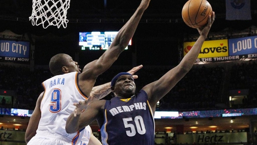 Memphis Grizzlies forward Zach Randolph (50) shoots next to Oklahoma City Thunder forward Serge Ibaka (9) during the first quarter of an NBA basketball game in Oklahoma City, Friday, Nov. 7, 2014. (AP Photo/Sue Ogrocki)