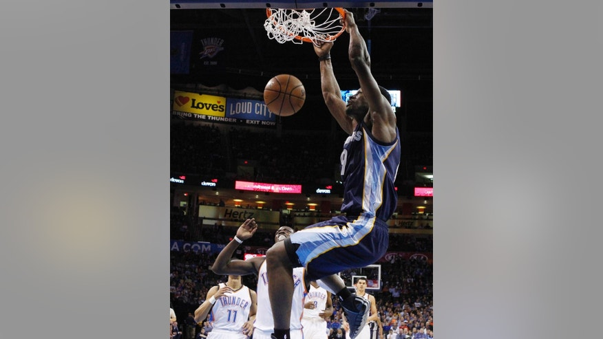 Memphis Grizzlies guard Tony Allen (9) dunks in front of Oklahoma City Thunder guard Reggie Jackson, center, during the first quarter of an NBA basketball game in Oklahoma City, Friday, Nov. 7, 2014. (AP Photo/Sue Ogrocki)