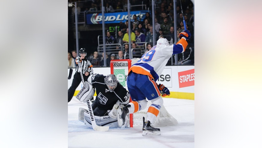 New York Islanders' Brock Nelson, right, celebrates his goal against Los Angeles Kings goalie Jonathan Quick during the first period of an NHL hockey game Thursday, Nov. 6, 2014, in Los Angeles. (AP Photo/Jae C. Hong)