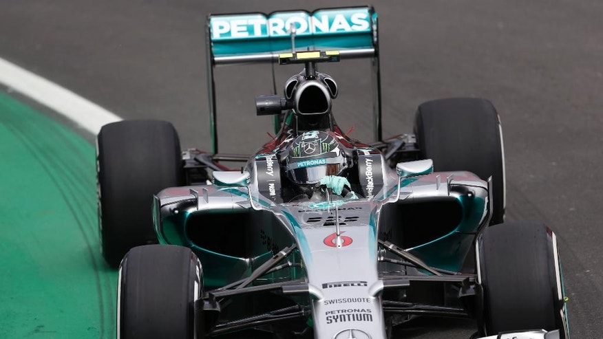 Mercedes driver Nico Rosberg, of Germany, steers his car on the pit lane during a free practice for the Formula One Brazilian Grand Prix at the Interlagos race track in Sao Paulo, Brazil, Friday, Nov. 7, 2014. (AP Photo/Silvia Izquierdo)
