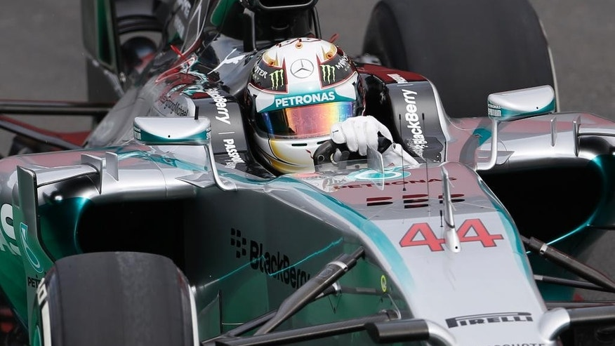 Mercedes driver Lewis Hamilton, of Britain, steers his car on the pit lane during a free practice for the Formula One Brazilian Grand Prix at the Interlagos race track in Sao Paulo, Brazil, Friday, Nov. 7, 2014. (AP Photo/Ricardo Mazalan)