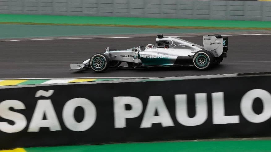 Mercedes driver Lewis Hamilton, of Britain, steers his car during a free practice for the Formula One Brazilian Grand Prix at the Interlagos race track in Sao Paulo, Brazil, Friday, Nov. 7, 2014. (AP Photo/Ricardo Mazalan)