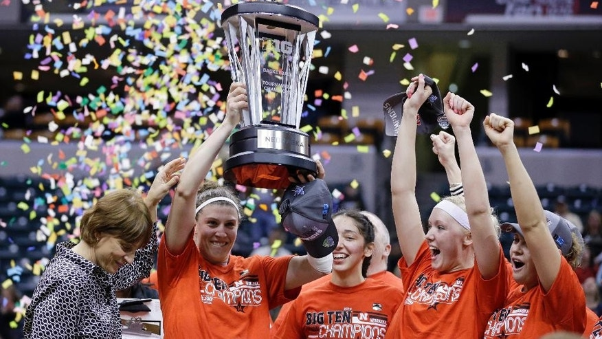 FILE - In this March 9, 2014, file photo, Nebraska head coach Connie Yori, left, along with players, from left, Jordan Hooper, Rachel Theriot, Emily Cady and Hailie Sample celebrate with the trophy after winning the Big Ten tournament in Indianapolis. The 16th-ranked Cornhuskers enter this season on the best roll in program history.  (AP Photo/Michael Conroy, File)