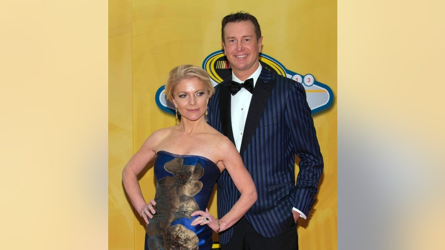 FILE - In this Dec. 6, 2013, file photo, Kurt Busch and Patricia Driscoll arrive at the NASCAR Sprint Cup Series auto racing awards ceremony at The Wynn Resort & Casino in Las Vegas. Police in Delaware say they are investigating a domestic assault allegation made against NASCAR driver Kurt Busch. The Dover Police Department said in a statement Friday, Nov. 7, 2014,  that the allegations were brought to the department on Wednesday. His ex-girlfriend, Patricia Driscoll, said the allegations involved an incident inside his motorhome at a race. (AP Photo/Eric Jamison, File)