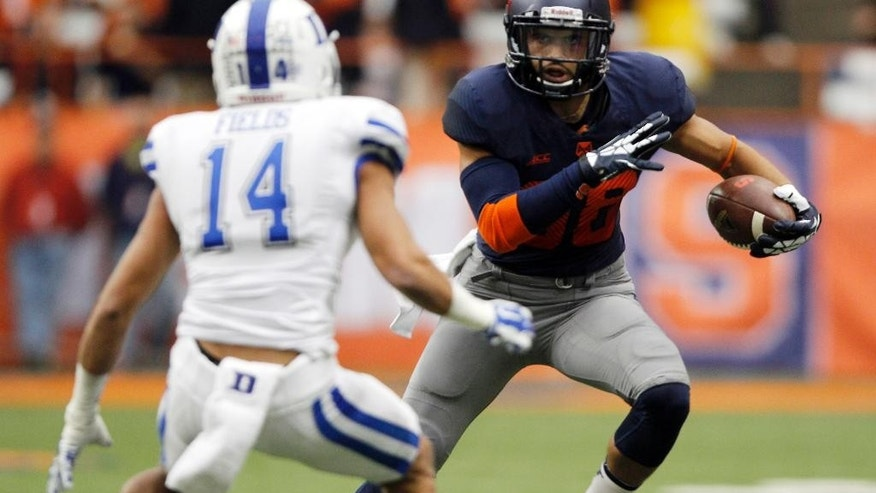 Syracuse's Jarrod West, right, makes a move against Duke's Byron Fields, left, in the second quarter of an NCAA college football game in Syracuse, N.Y., Saturday, Nov. 8, 2014. (AP Photo/Nick Lisi)
