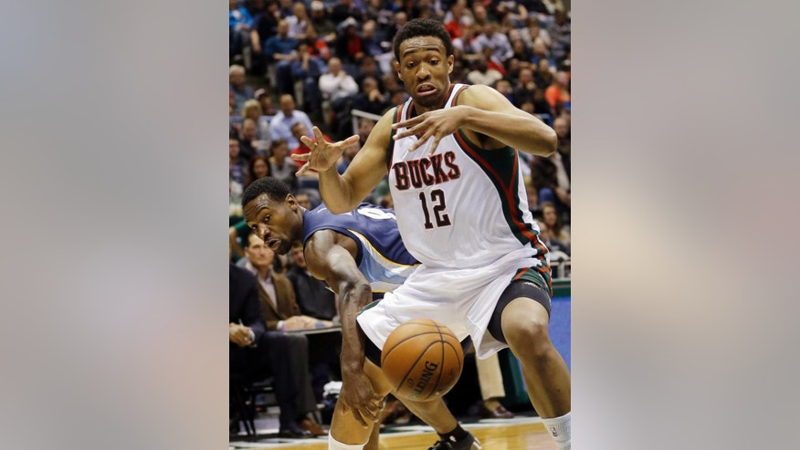Memphis Grizzlies' Tony Allen, left, knocks the ball away from Milwaukee Bucks' Jabari Parker (12) during the first half of an NBA basketball game Saturday, Nov. 8, 2014, in Milwaukee. (AP Photo/Morry Gash)