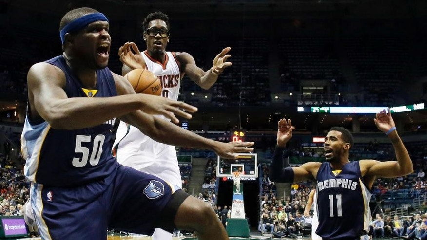Memphis Grizzlies' Zach Randolph (50) knocks the ball away from Milwaukee Bucks' Larry Sanders during the first half of an NBA basketball game Saturday, Nov. 8, 2014, in Milwaukee. (AP Photo/Morry Gash)