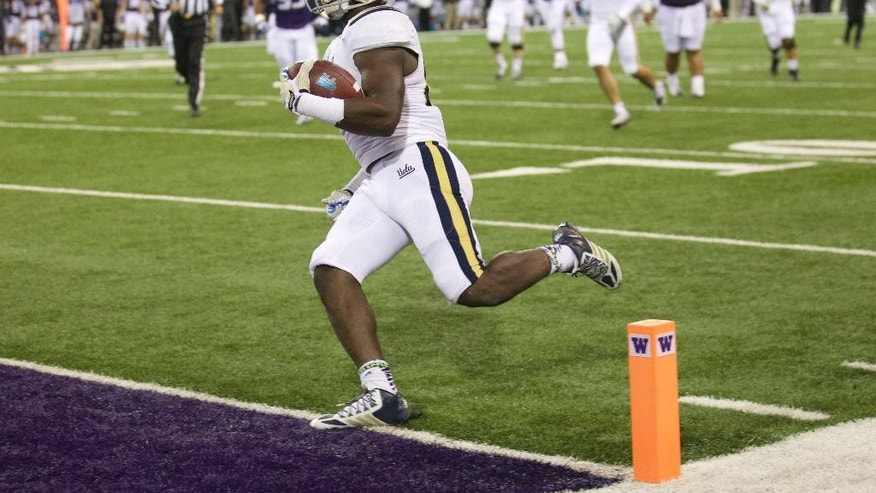 UCLA running back Myles Jack scores a touchdown in the first half of an NCAA college football game against Washington, Saturday, Nov. 8, 2014, in Seattle. (AP Photo/Stephen Brashear)