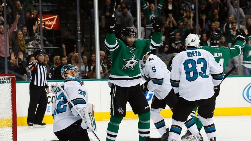 Dallas Stars' Erik Cole (72) celebrates a goal by Tyler Seguin in front of San Jose Sharks goalie Alex Stalock (32) and Sharks' Matt Nieto (83) during the first period of an NHL hockey game, Saturday, Nov. 8, 2014, in Dallas. (AP Photo/Tony Gutierrez)