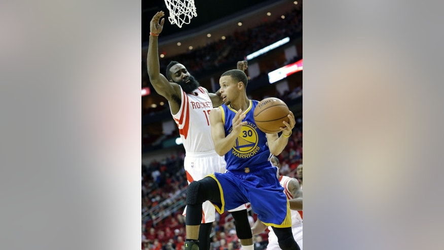 Golden State Warriors' Stephen Curry (30) is pressured by Houston Rockets' James Harden in the first half of an NBA basketball game Saturday, Nov. 8, 2014, in Houston. (AP Photo/Pat Sullivan)