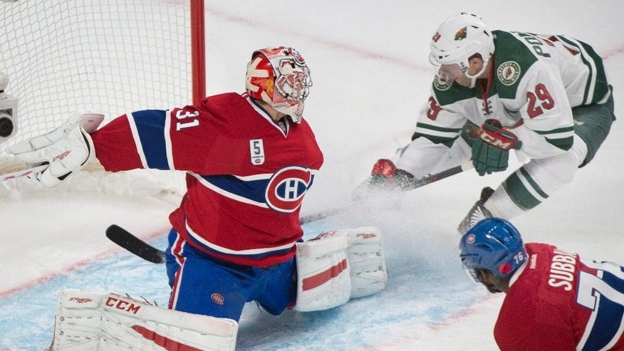 Montreal Canadiens goaltender Carey Price is scored on by Minnesota Wild's Jason Pominville, right, as Canadiens' P.K Subban (76) defends during the second period of an NHL hockey game Saturday, Nov. 8, 2014, in Montreal. (AP Photo/The Canadian Press, Graham Hughes)