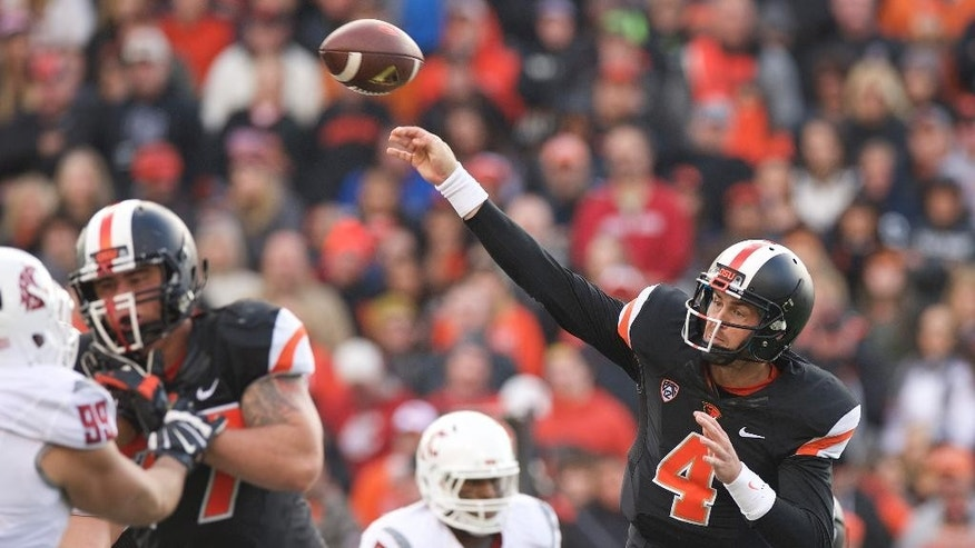 Oregon State quarterback Sean Mannion (4) passes against Washington State during an NCAA college football game in Corvallis, Ore., Saturday, Nov. 8, 2014. (AP Photo/Troy Wayrynen)