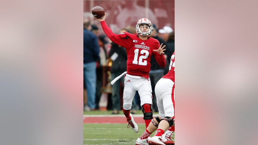 Indiana quarterback Zander Diamont (12) throws in first half of an NCAA college football game in Bloomington, Ind., Saturday, Nov. 8, 2014. (AP Photo/Sam Riche)
