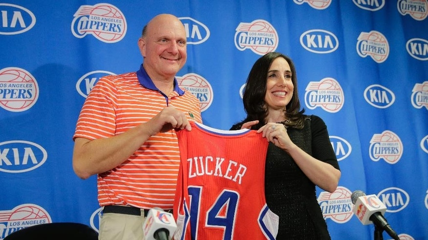 Los Angeles Clippers owner Steve Ballmer. left, poses with the new president of business operations, Gillian Zucker, during a news conference before an NBA basketball game against the Portland Trail Blazers, Saturday, Nov. 8, 2014, in Los Angeles. (AP Photo/Jae C. Hong)
