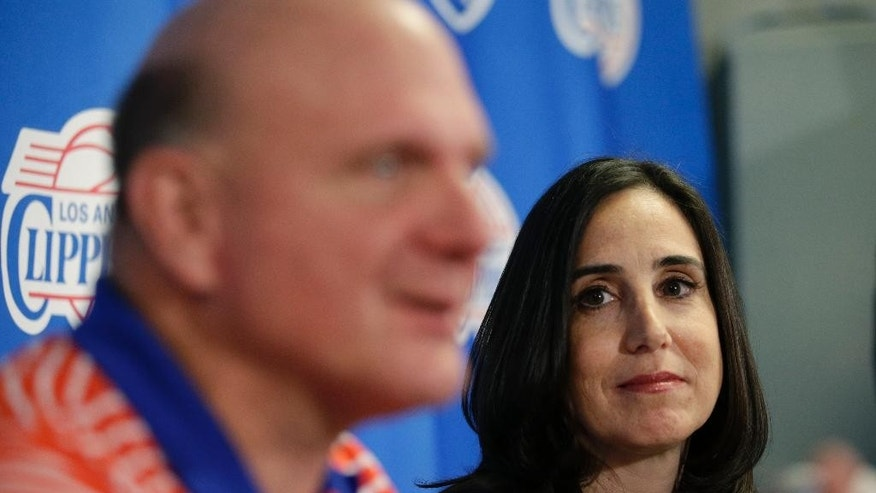 Los Angeles Clippers' new president of business operations Gillian Zucker, right, listens to owner Steve Ballmer during a news conference held before an NBA basketball game against the Portland Trail Blazers Saturday, Nov. 8, 2014, in Los Angeles. (AP Photo/Jae C. Hong)