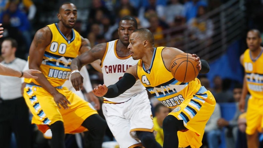 Denver Nuggets guard Randy Foye works ball inside as Cleveland Cavaliers guard Dion Waiters, center, and Nuggets forward Darrell Arthur watch during the first quarter of an NBA basketball game in Denver on Friday, Nov. 7, 2014. (AP Photo/David Zalubowski)