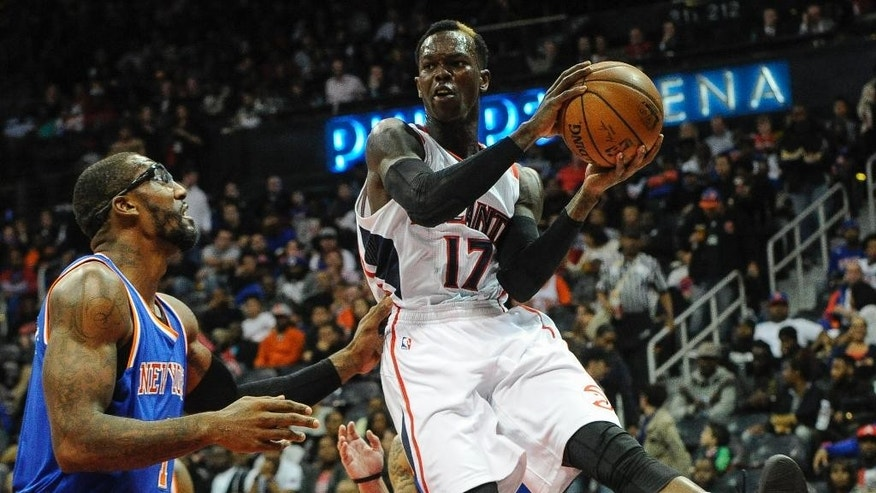 Atlanta Hawks guard Dennis Schroder (17), of Germany, shoots as New York Knicks forward Amare Stoudemire (1) defends during the first half of an NBA basketball game, Saturday, Nov. 8, 2014, in Atlanta. (AP Photo/John Amis)