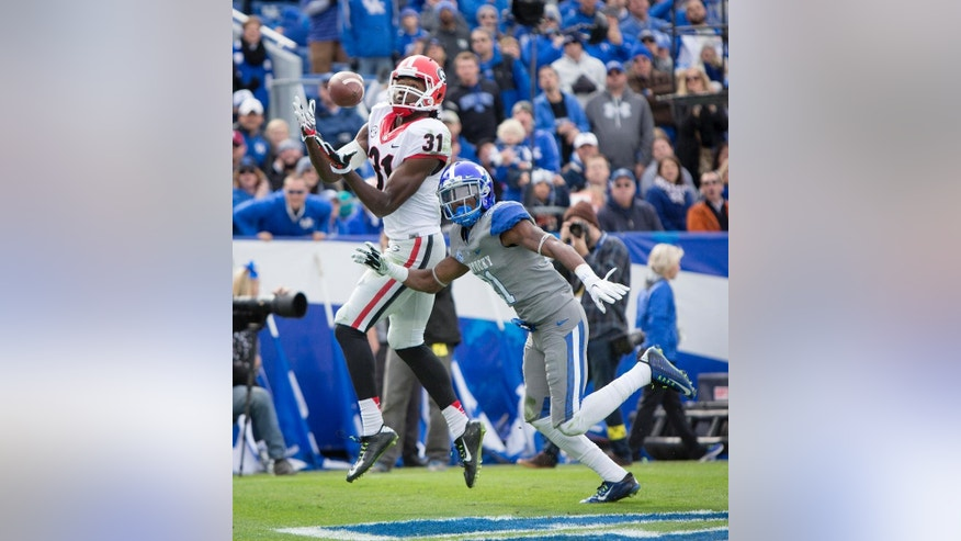 Georgia wide receiver Chris Conley hauls in a touchdown over Kentucky cornerback Nate Willis during the first half of an NCAA college football game at Commonwealth Stadium in Lexington, Ky., Saturday, Nov. 8, 2014. (AP Photo/David Stephenson)