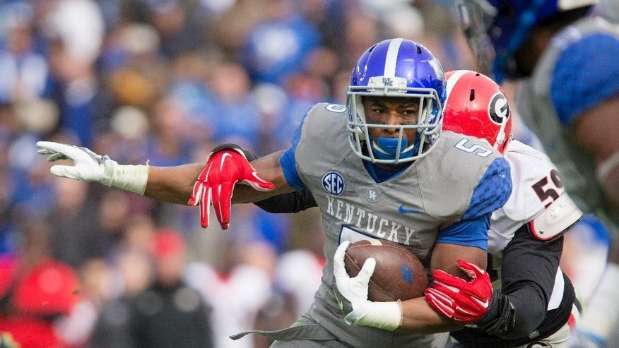 Kentucky running back Braylon Heard is wrapped up by Georgia linebacker Jordan Jenkins, right, during the first half of an NCAA college football game at Commonwealth Stadium in Lexington, Ky., Saturday, Nov. 8, 2014. (AP Photo/David Stephenson)