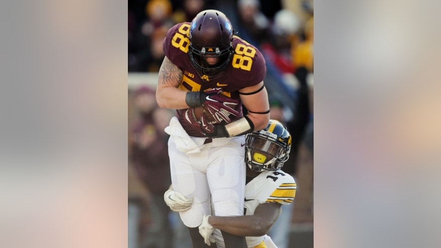 Minnesota tight end Maxx Williams (88) makes a catch for a touchdown against Iowa defensive back Desmond King (14) during the first half of an NCAA college football game on Saturday, Nov. 8, 2014, in Minneapolis. (AP Photo/Hannah Foslien)