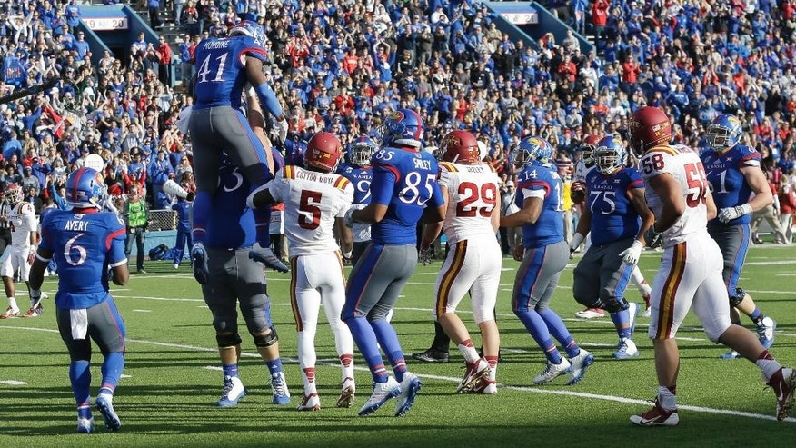 Kansas celebrates a touchdown by tight end Jimmay Mundine (41) during the first half of an NCAA college football game against Iowa State in Lawrence, Kan., Saturday, Nov. 8, 2014. (AP Photo/Orlin Wagner)