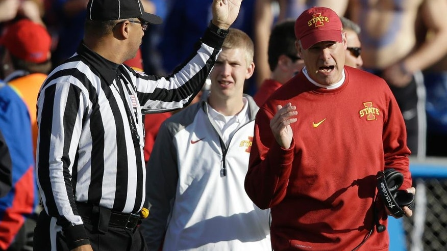 Iowa State head coach Paul Rhoads, right, has words with line judge Frank LeBlanc, left, during the first half of an NCAA college football game against Kansas in Lawrence, Kan., Saturday, Nov. 8, 2014. (AP Photo/Orlin Wagner)