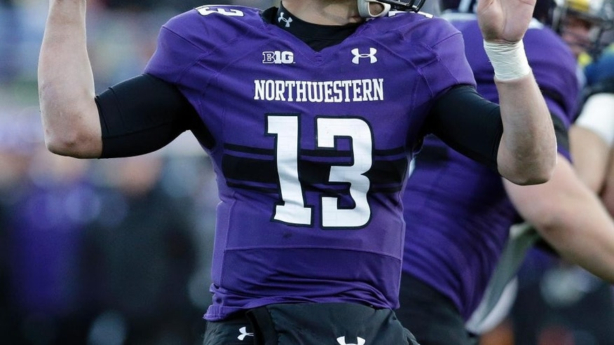 Northwestern quarterback Trevor Siemian (13) looks to a pass against Michigan during the first half of an NCAA college football game in Evanston, Ill., Saturday, Nov. 8, 2014. (AP Photo/Nam Y. Huh)