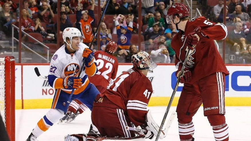 New York Islanders' Anders Lee (27) skates off to celebrate a goal by teammate Frans Nielsen against Arizona Coyotes' Mike Smith (41) as Coyotes' Connor Murphy (5) looks on and Brandon McMillan (22) skates away during the third period of an NHL hockey game Saturday, Nov. 8, 2014, in Glendale, Ariz.  The Islanders defeated the Coyotes 1-0. (AP Photo/Ross D. Franklin)
