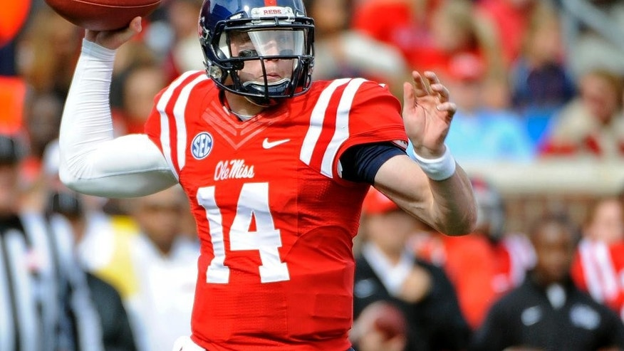 Mississippi quarterback Bo Wallace (14) releases a pass during the first half of an NCAA college football game against Presbyterian in Oxford, Miss., Saturday, Nov. 8, 2014. (AP Photo/Thomas Graning)