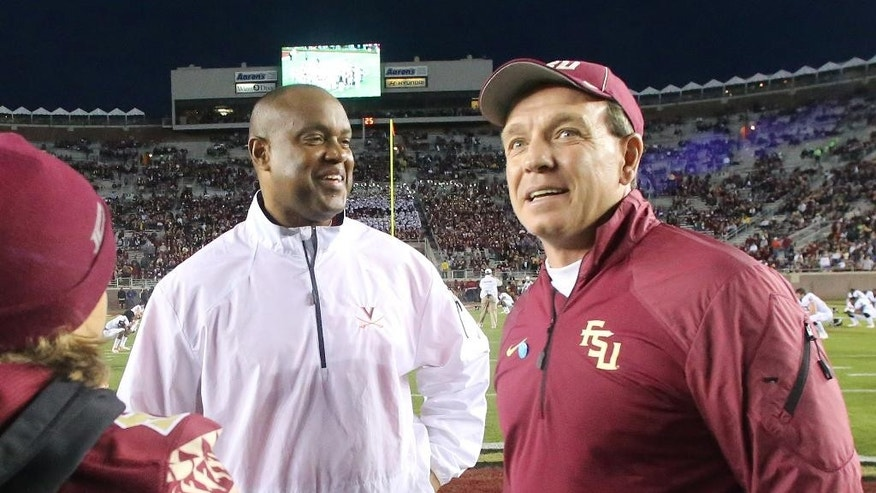 Florida State head coach Jimbo Fisher, right, talks with Virginia head coach Mike London before an NCAA college football game, Saturday, Nov. 8, 2014, in Tallahassee, Fla. (AP Photo/Steve Cannon)