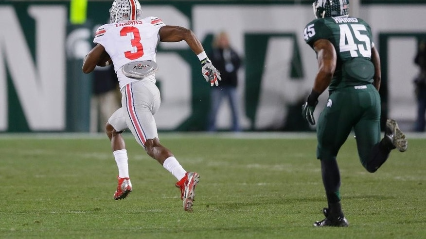 Ohio State wide receiver Michael Thomas (3) breaks away from Michigan State linebacker Darien Harris (45) on a 79-yard touchdown run during the first half of an NCAA college football game in East Lansing, Mich., Saturday, Nov. 8, 2014. (AP Photo/Carlos Osorio)