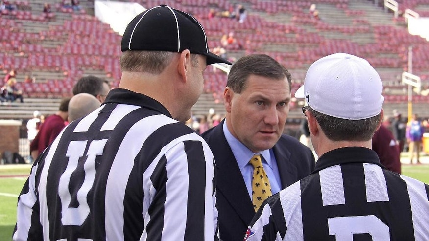 Mississippi State coach Dan Mullen, center. meets with umpire Johnn Hibbett, left and referee, Marc Curlee, right, prior to an NCAA college football game against UT-Martin and in Starkville, Miss., Saturday, Nov. 8, 2014. (AP Photo/Jim Lytle)