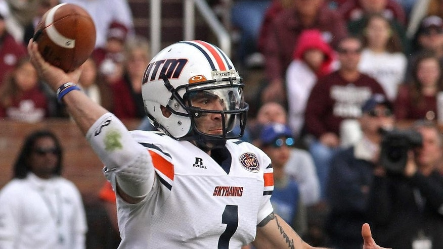 UT-Martin quarterback Dylan Favre (1) throws a pass during the first half of an NCAA college football game against Mississippi State in Starkville, Miss., Saturday, Nov. 8, 2014. (AP Photo/Jim Lytle)
