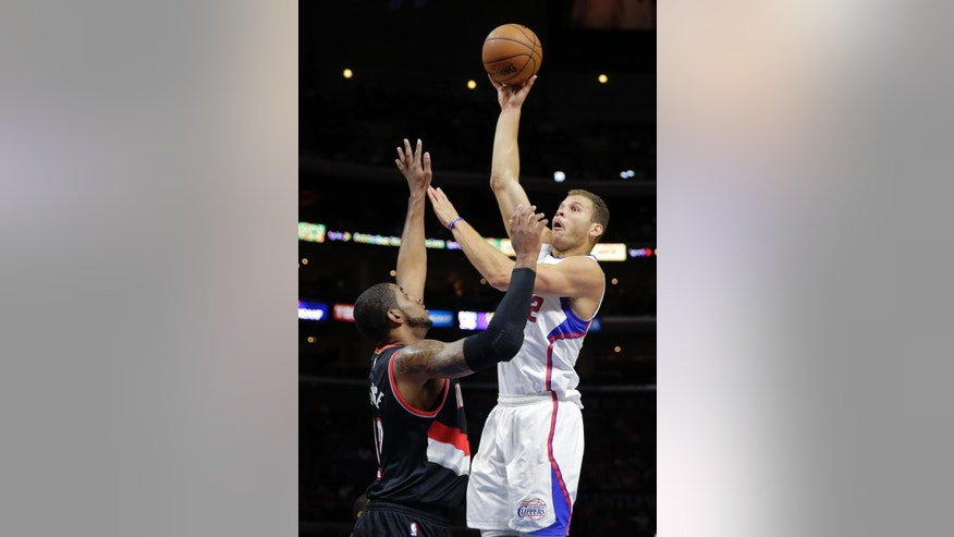 Los Angeles Clippers' Blake Griffin, right, shoots over Portland Trail Blazers' LaMarcus Aldridge during the first half of an NBA basketball game Saturday, Nov. 8, 2014, in Los Angeles. (AP Photo/Jae C. Hong)
