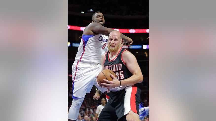 Portland Trail Blazers' Chris Kaman, front, gets a rebound against Los Angeles Clippers' Glen Davis during the first half of an NBA basketball game Saturday, Nov. 8, 2014, in Los Angeles. (AP Photo/Jae C. Hong)