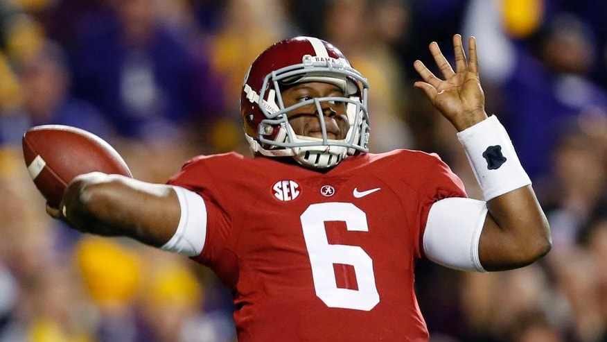 Alabama quarterback Blake Sims passes in the first half of an NCAA college football game against Alabama in Baton Rouge, La., Saturday, Nov. 8, 2014. (AP Photo/Jonathan Bachman)