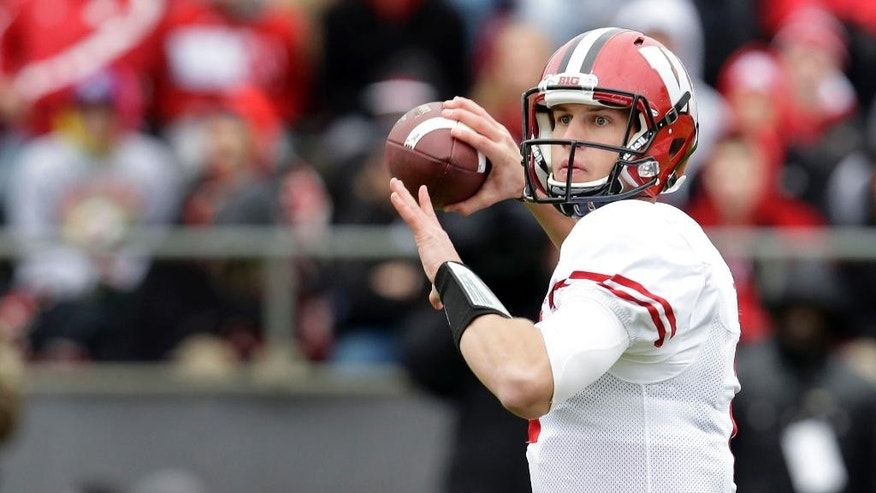 Wisconsin quarterback Joel Stave (2) throws against Purdue during the first half of an NCAA college football game in West Lafayette, Ind., Saturday, Nov. 8, 2014. (AP Photo/AJ Mast)