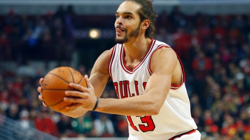 Chicago Bulls center Joakim Noah looks to shoot against the Boston Celtics during the first half of an NBA basketball game in Chicago on Saturday, Nov. 8, 2014. (AP Photo/Jeff Haynes)