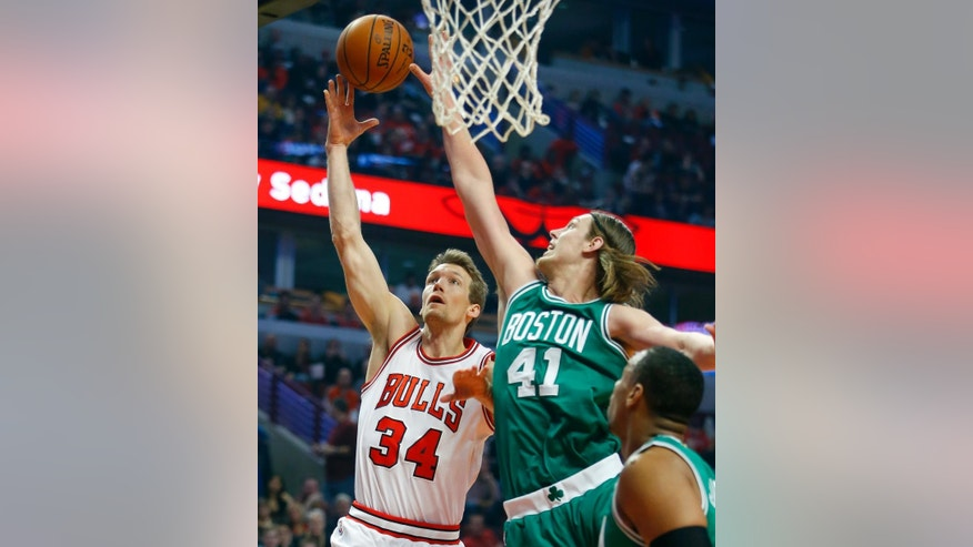 Chicago Bulls forward Mike Dunleavy (34) shoots next to Boston Celtics center Kelly Olynyk (41) during the first half of an NBA basketball game in Chicago on Saturday, Nov. 8, 2014. (AP Photo/Jeff Haynes)