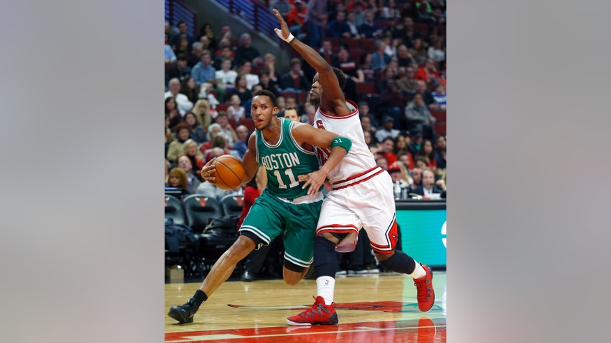 Boston Celtics guard Evan Turner (11) gets around Chicago Bulls guard Jimmy Butler (21) during the second half of an NBA basketball game in Chicago on Saturday, Nov. 8, 2014. The Celtics won the game 106-101.  (AP Photo/Jeff Haynes)