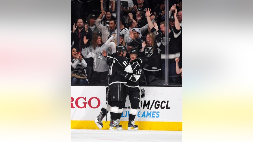 Los Angeles Kings center Anze Kopitar, left, of Slovenia, celebrates his goal with right wing Marian Gaborik, of Slovakia, during the first period of an NHL hockey game against the Los Angeles Kings, Saturday, Nov. 8, 2014, in Los Angeles. (AP Photo/Mark J. Terrill)