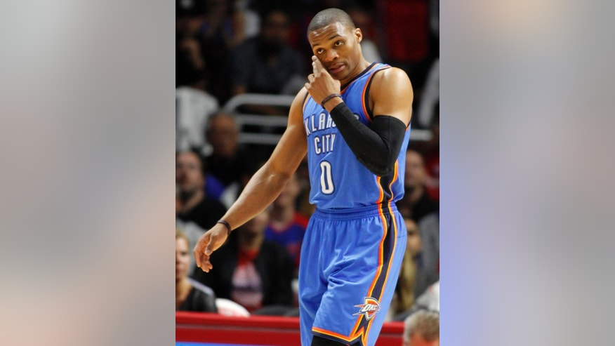 FILE - In this Oct. 30, 2014, file photo, Oklahoma City Thunder guard Russell Westbrook (0) wipes his face  during the first half of an NBA basketball game against the Los Angeles Clippers in Los Angeles. (AP Photo/Alex Gallardo, File(