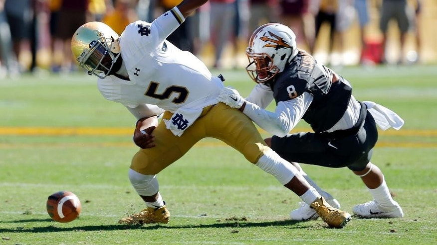 Arizona State defensive back Lloyd Carrington (8) sacks Notre Dame quarterback Everett Golson (5) during the first half of an NCAA college football game, Saturday, Nov. 8, 2014, in Tempe, Ariz. (AP Photo/Rick Scuteri)