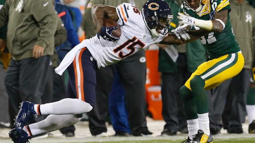 Chicago Bears wide receiver Brandon Marshall (15) runs against Green Bay Packers cornerback Sam Shields (37) after receiving a pass during the first half of an NFL football game Sunday, Nov. 9, 2014, in Green Bay, Wis. (AP Photo/Mike Roemer)