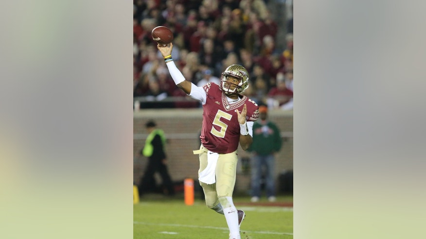 Florida State's Jameis Winston throws for a completion against Virginia in the third quarter of an NCAA college football game, Saturday, Nov. 8, 2014, in Tallahassee, Fla. Florida State won the game 34-20. (AP Photo/Steve Cannon)