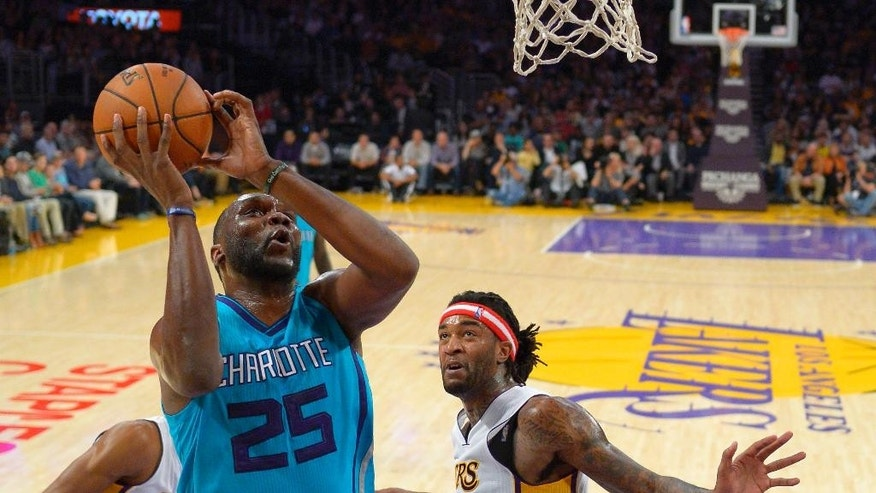 Charlotte Hornets center Al Jefferson shoots as Los Angeles Lakers center Jordan Hill defends during the first half of an NBA basketball game, Sunday, Nov. 9, 2014, in Los Angeles. (AP Photo/Mark J. Terrill)