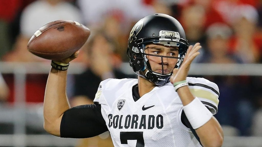 Colorado quarterback Jordan Gehrke throws against Arizona during the second half of an NCAA college football game, Saturday, Nov. 8, 2014, in Tucson, Ariz. Gehrke replaced the injured Sefo Liufau. (AP Photo/Rick Scuteri)