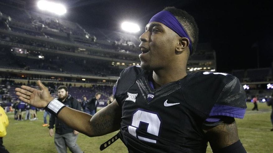 TCU quarterback Trevone Boykin is congratulated as he walks off the field after an NCAA college football game against Kansas State on Saturday, Nov. 8, 2014, in Fort Worth, Texas. TCU 41-20. (AP Photo/LM Otero)