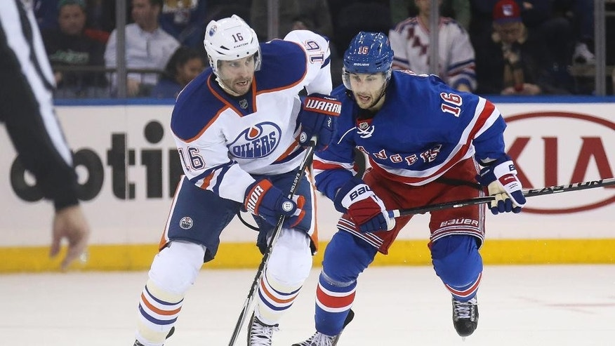 Edmonton Oilers right wing Teddy Purcell, left, skates against New York Rangers center Derick Brassard during the third period of an NHL hockey game at Madison Square Garden, Sunday, Nov. 9, 2014, in New York. The Oilers won 3-1. (AP Photo/John Minchillo)