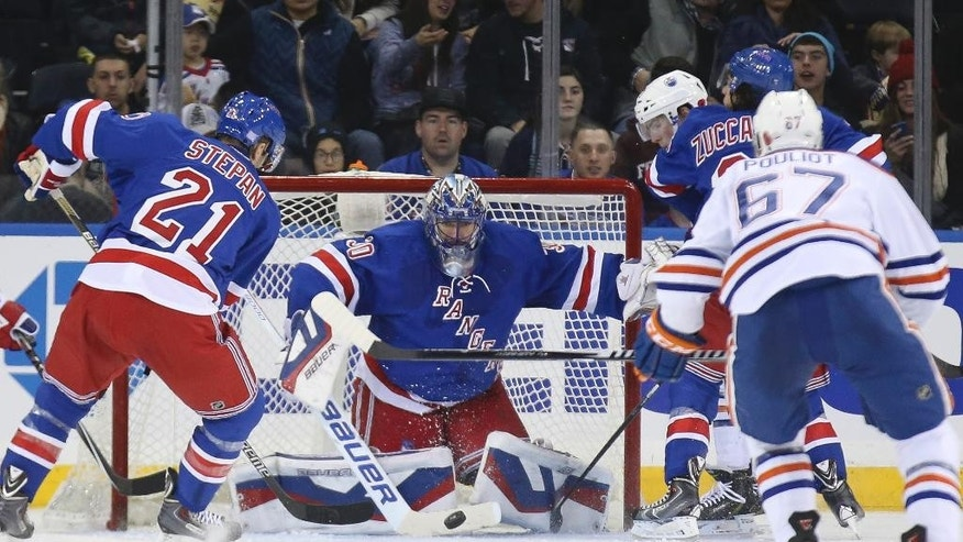 New York Rangers goalie Henrik Lundqvist (30) makes a save during the second period of an NHL hockey game against the Edmonton Oilers at Madison Square Garden, Sunday, Nov. 9, 2014, in New York. (AP Photo/John Minchillo)